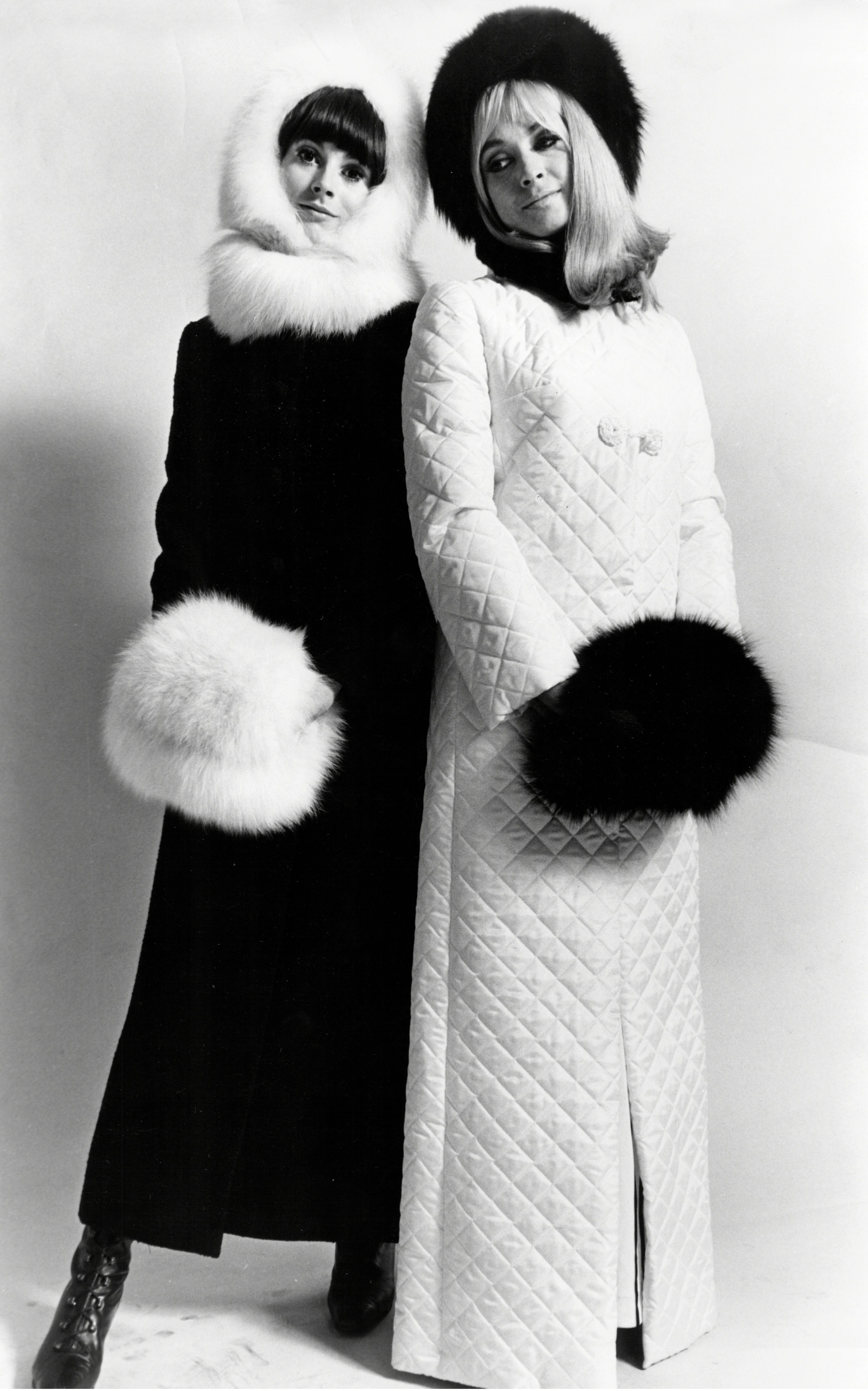 The Zhivago Look. Long Black Wool Coat 22 Gns. At Jaeger. White Fox Hood 18gns. White Fox Collar 14gns. White Fox Muff 18gns. All At Femina Furs. The Zhivago Look In A Long White Quilted Coat With Hussar-type Fastening A16.15.6. Black Musquash Collar