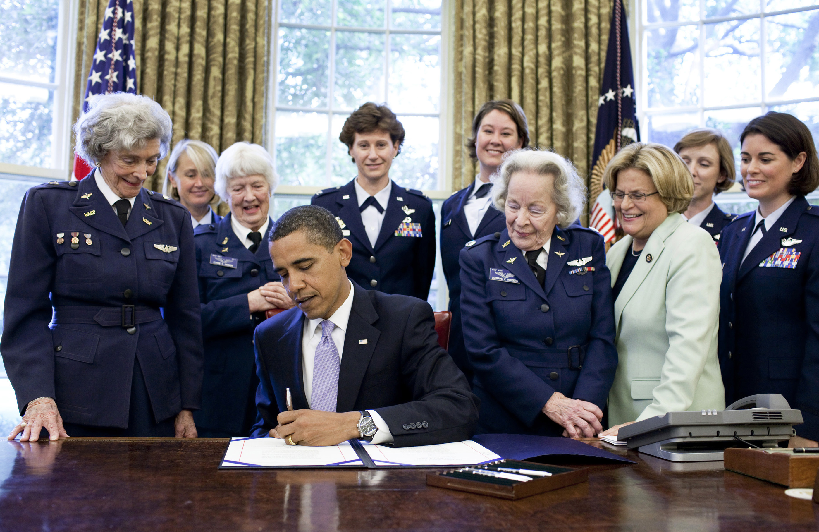 President Barack Obama signs S.614 in the Oval Office July 1 at the White House. The bill awards a Congressional Gold Medal to Women Airforce Service Pilots. The WASP program was established during World War II, and from 1942 to 1943, more than 1,000 women joined, flying 60 million miles of noncombat military missions. Of the women who received their wings as Women Airforce Service Pilots, approximately 300 are living today. (Official White House photo/Pete Souza)
