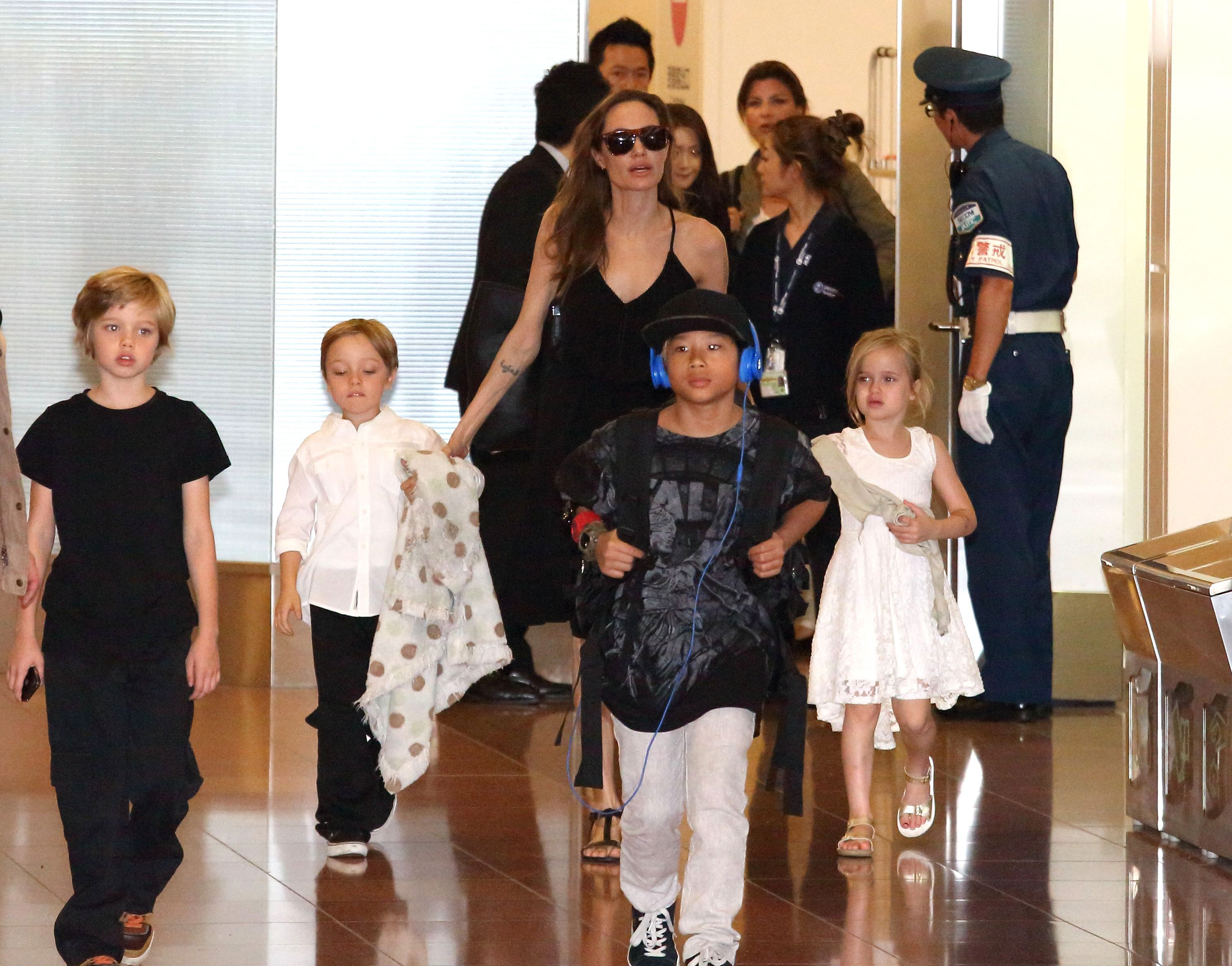 Mandatory Credit: Photo by Masatoshi Okauchi/REX/Shutterstock (3854763a) Angelina Jolie and children Shiloh Jolie-Pitt, Knox Jolie-Pitt, Pax Jolie-Pitt and Vivienne Jolie-Pitt Angelina Jolie and family at Haneda International airport, Tokyo, Japan - 21 Jun 2014 Angelina Jolie and family arrives in Japan to attend the Japanese premiere of the movie 'Maleficent', which will be released on July 5th